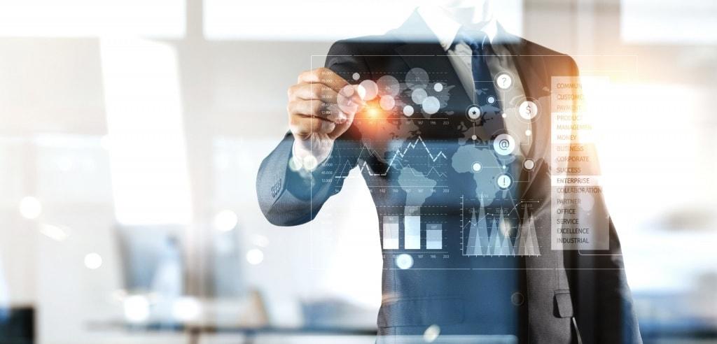 Businessman using advanced financial software