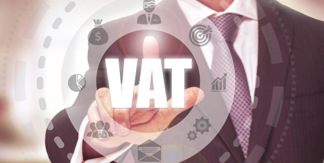 Business man pressing digital VAT button